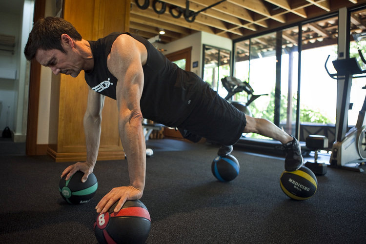 SANTA MONICA, CA --AUGUST 03, 2010--Tony Horton, 52, fitness personality and the face of the workout video system P90X, is photographed demonstrating a workout from his hit series, in his Santa Monica home gym, Aug. 3, 2010. (Photo by Jay L. Clendenin/Los Angeles Times)